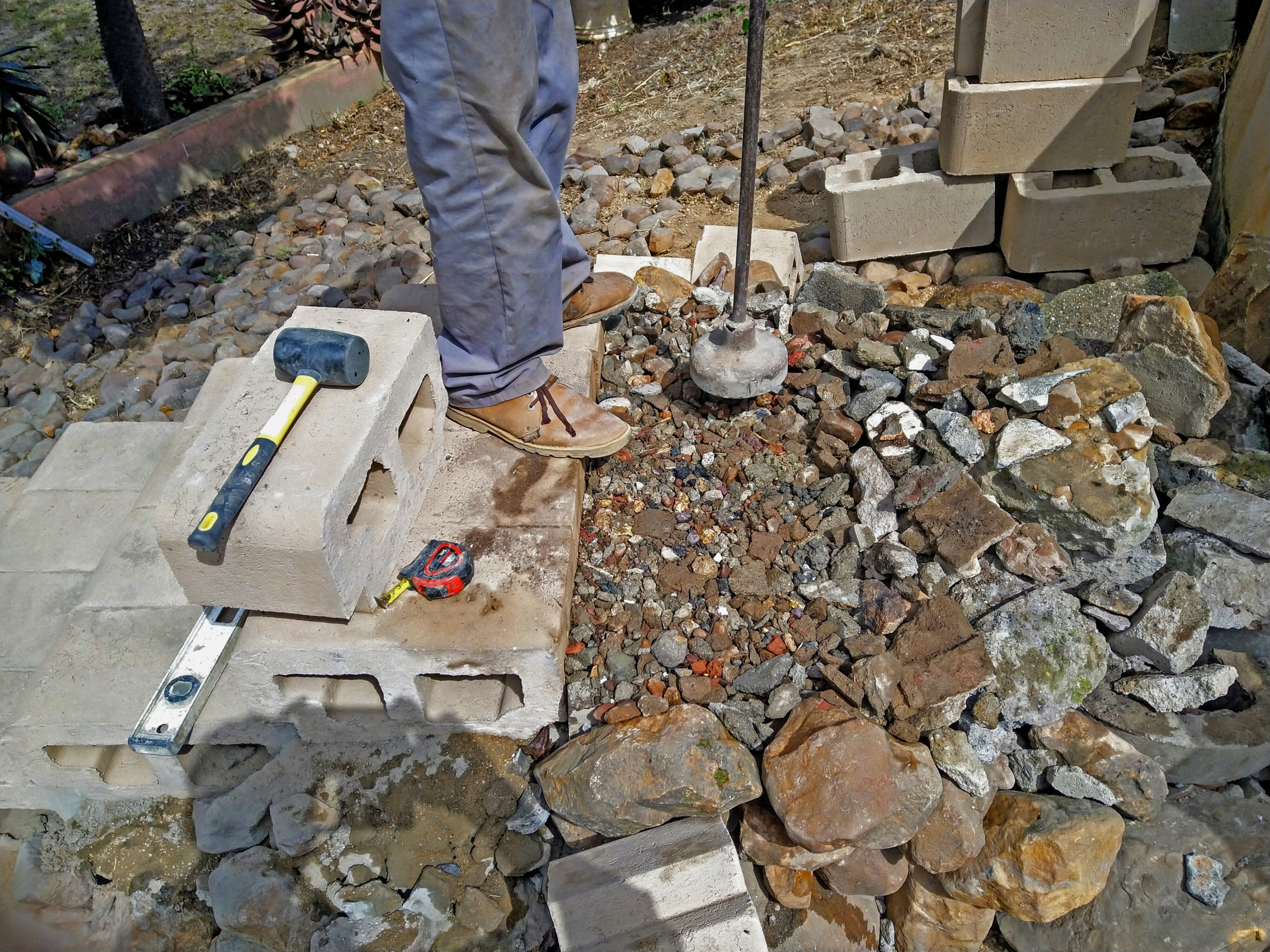 Using builder's rubble for a foundation, well compacted