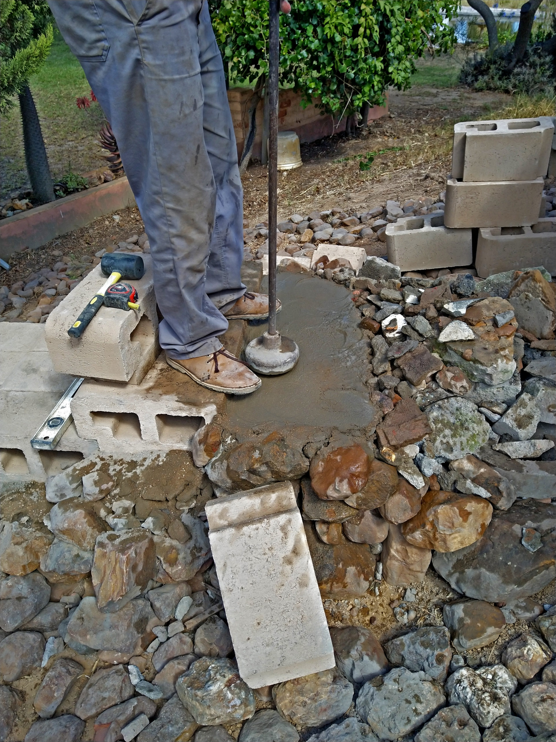 Compact moist sand cement mix and level out for next layer of steps